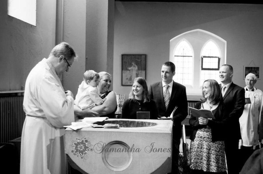 Godparents at font St John the Evangelist Bromley