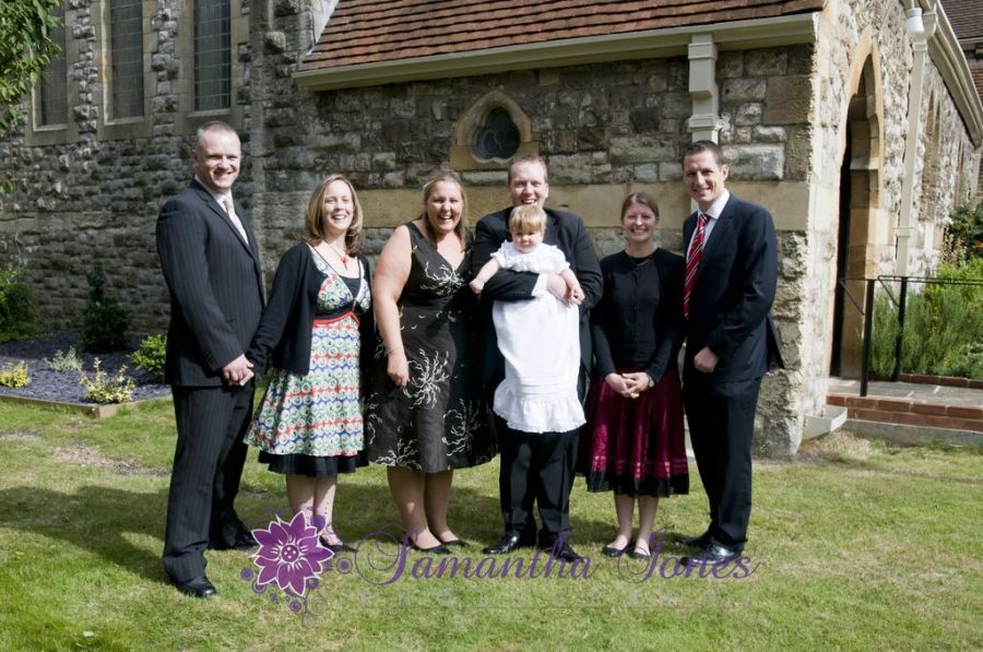 Godparents and parents outside church at St John the Evangelist in Bromley