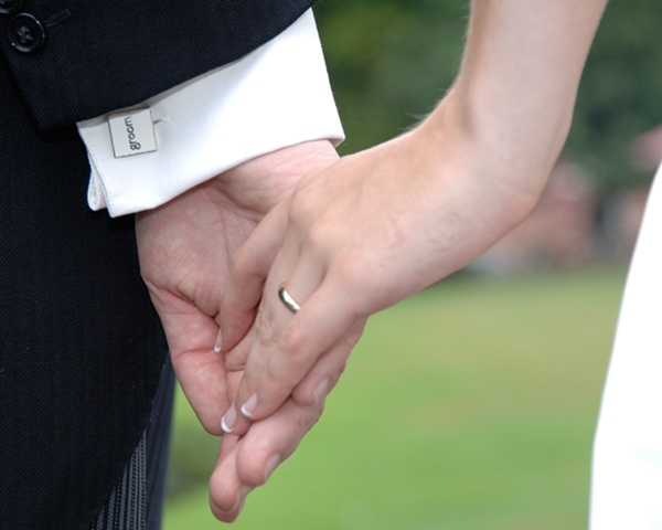 Helen Carter Bride and groom hands (Stephen Sutton Photography)