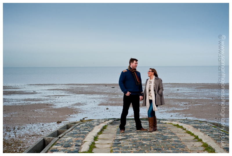 Jemma had chosen some appropriate jewellery too.  <img src= and Rob pre-wedding photoshoot in Whitstable copyright Samantha Jones Photography
