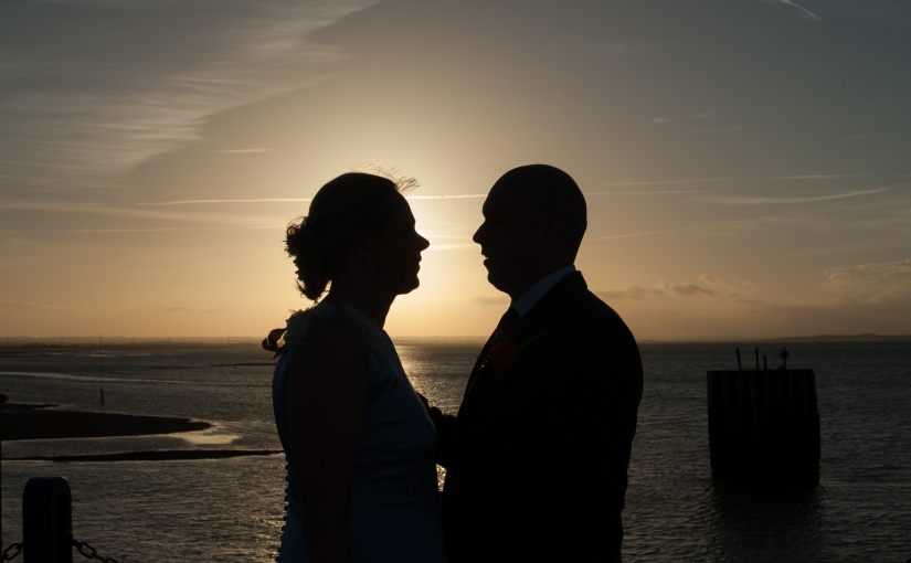 An October wedding by the seaside, complete with sunset and pumpkins … Jill and Kevin and the full story of their wedding at East Quay